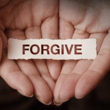 Forgive text on hand design concept